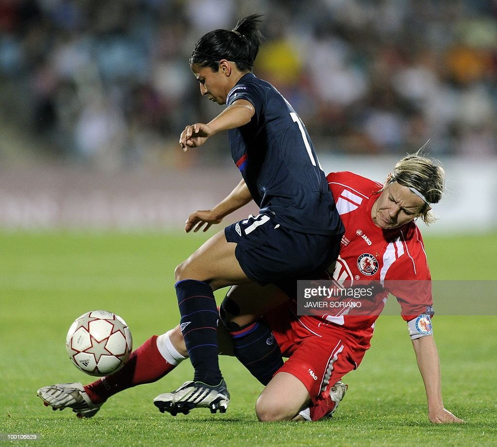 Olympique Lyonnais' Costa Rican midfielder Shirley Cruz Trana (L) vies with FFC Turbine Potsdam's midfielder Jennifer Zietz (R) during their UEFA women's Champions League final football match beetwen Olympique Lyonnais and FFC Turbine Potsdam at the Coliseum Alfonso Perez stadium in Getafe on May 20, 2010. near Madrid.