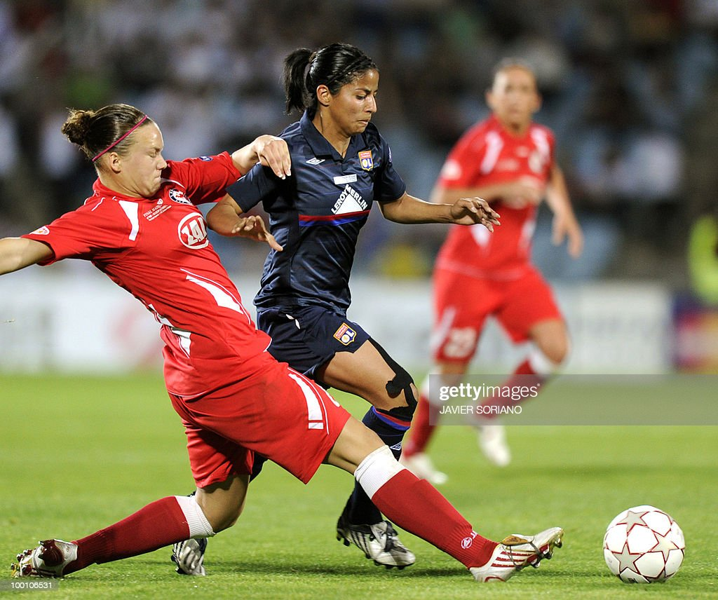 Olympique Lyonnais' Costa Rican midfielder Shirley Cruz Trana (R) vies with FFC Turbine Potsdam's defender Josephine Henning (L) during their UEFA Women's Champions League final football match beetwen Olympique Lyonnais and FFC Turbine Potsdam at the Coliseum Alfonso Perez stadium in Getafe near Madrid on May 20, 2010.