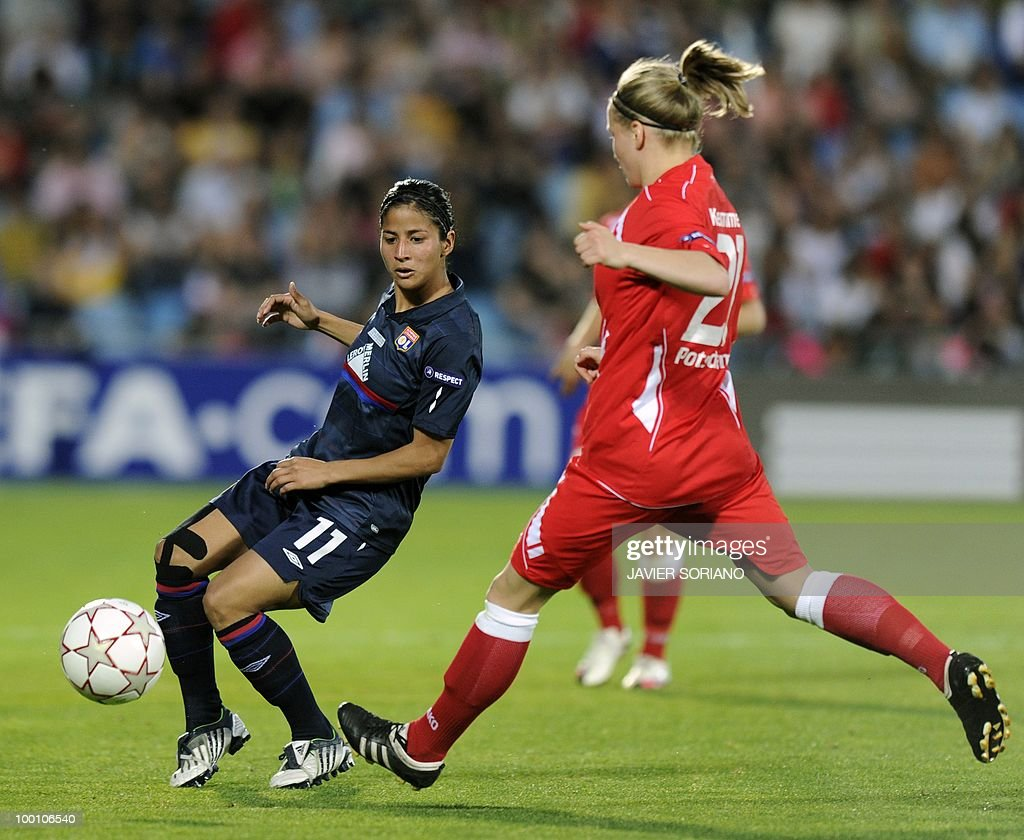 Olympique Lyonnais' Costa Rican midfielder Shirley Cruz Trana (L) vies with Olympique Lyonnais' Swiss midfielder Lara Dickenmann during their UEFA women's Champions League final football match beetwen Olympique Lyonnais and FFC Turbine Potsdam at the Coliseum Alfonso Perez stadium in Getafe on May 20, 2010. near Madrid.