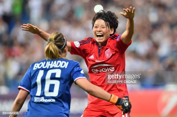 Olympique Lyonnais' defender from Japan Saki Kumagai celebrates with teammate goalkeeper Sarah Bouhaddi after scoring the winning penalty at the end...