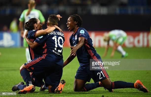 Olympique Lyonnais' Dutch forward Shanice Van De Sandern Olympique Lyonnais' Canadian defender Kadeisha Buchanan and a teammate celebrate their...