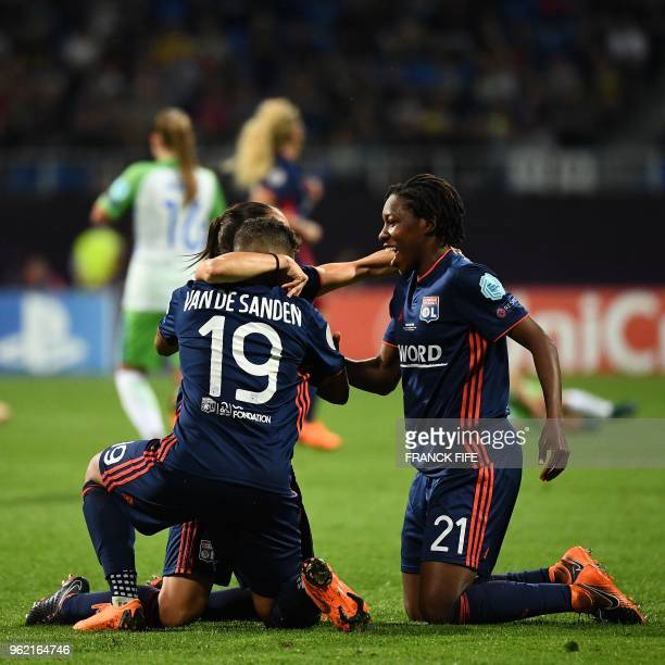 Olympique Lyonnais' Dutch forward Shanice Van De Sandern Olympique Lyonnais' Canadian defender Kadeisha Buchanan and a teammate celebrate their...