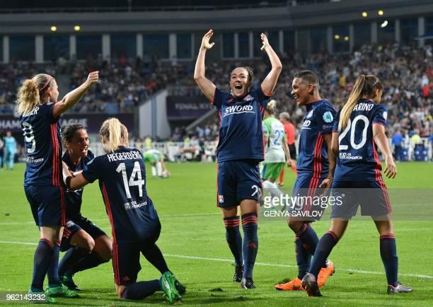 Olympique Lyonnais' English defender Lucy Bronze Olympique Lyonnais' Dutch forward Shanice Van De Sandern and teammates celebrate after scoring...