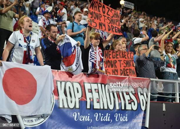 Olympique Lyonnais' fans cheer their team during the UEFA Women's Champions League final football match Vfl Wolfsburg vs Olympique Lyonnais at the...