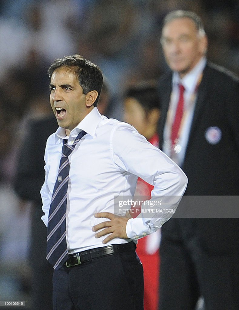 Olympique Lyonnais' French coach Farid Benstiti shouts during their Final women's Champions League football match against Turbine Potsdam at Coliseum Alfonso Pérez on May 20, 2010 in Getafe.