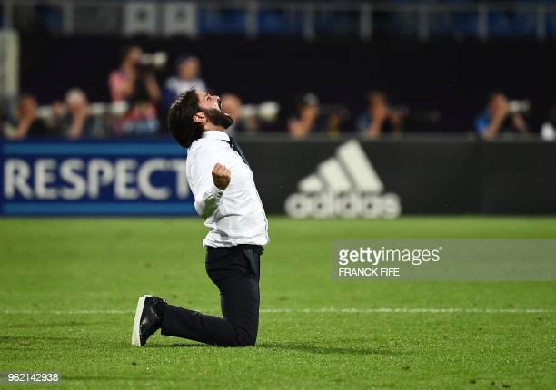 TOPSHOT Olympique Lyonnais' French coach Reynald Pedros celebrates after his team scored during the UEFA Women's Champions League final football...