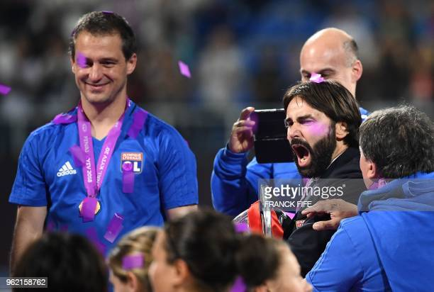 Olympique Lyonnais' French coach Reynald Pedros celebrates their victory at the end of the UEFA Women's Champions League final football match Vfl...