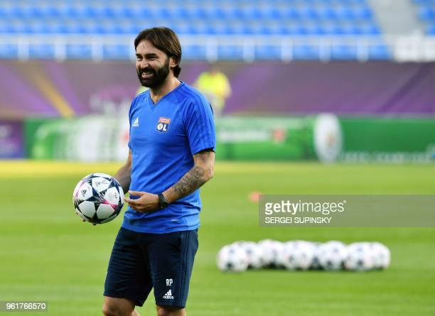 Olympique Lyonnais' French coach Reynald Pedros smiles during a training session at the Valeriy Lobanovsky Stadium in Kiev on May 23 on the eve of...