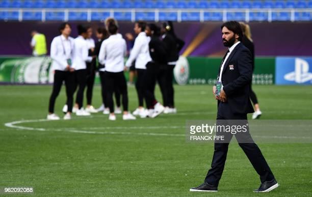 Olympique Lyonnais' French coach Reynald Pedros walks on the pitch before the UEFA Women's Champions League final football match Vfl Wolfsburg vs...