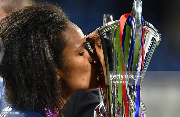 TOPSHOT Olympique Lyonnais' French defender Wendie Renard kisses the trophy after the UEFA Women's Champions League final football match Vfl...