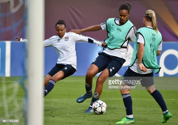 Olympique Lyonnais' French defender Wendie Renard trains with teammate during the training session at the Valeriy Lobanovsky Stadium in Kiev on May...