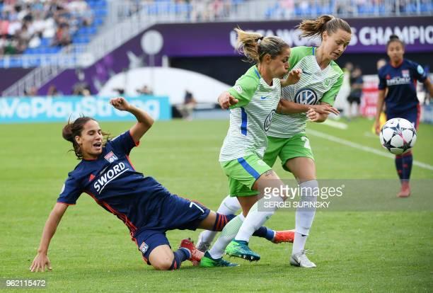 Olympique Lyonnais' French midfielder Amel majri vies with Wolfsburg's Polish forward Ewa Pajor and Wolfsburg's Swiss midfielder Lara Dickenmann...