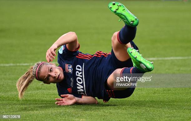 Olympique Lyonnais' French midfielder Eugenie Le Sommer falls during the UEFA Women's Champions League final football match Vfl Wolfsburg vs...