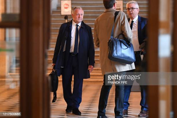 Olympique Lyonnais' French president JeanMichel Aulas and Olympique Lyonnais' French general deputy director Olivier Blanc chat with their lawyer...