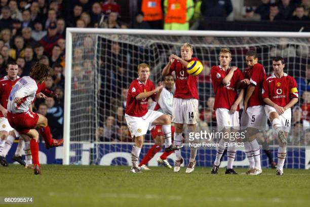 Olympique Lyonnais' Juninho hits a free kick into Manchester United's defensive wall of Paul Scholes Alan Smith Darren Fletcher Rio Ferdinand and Roy...