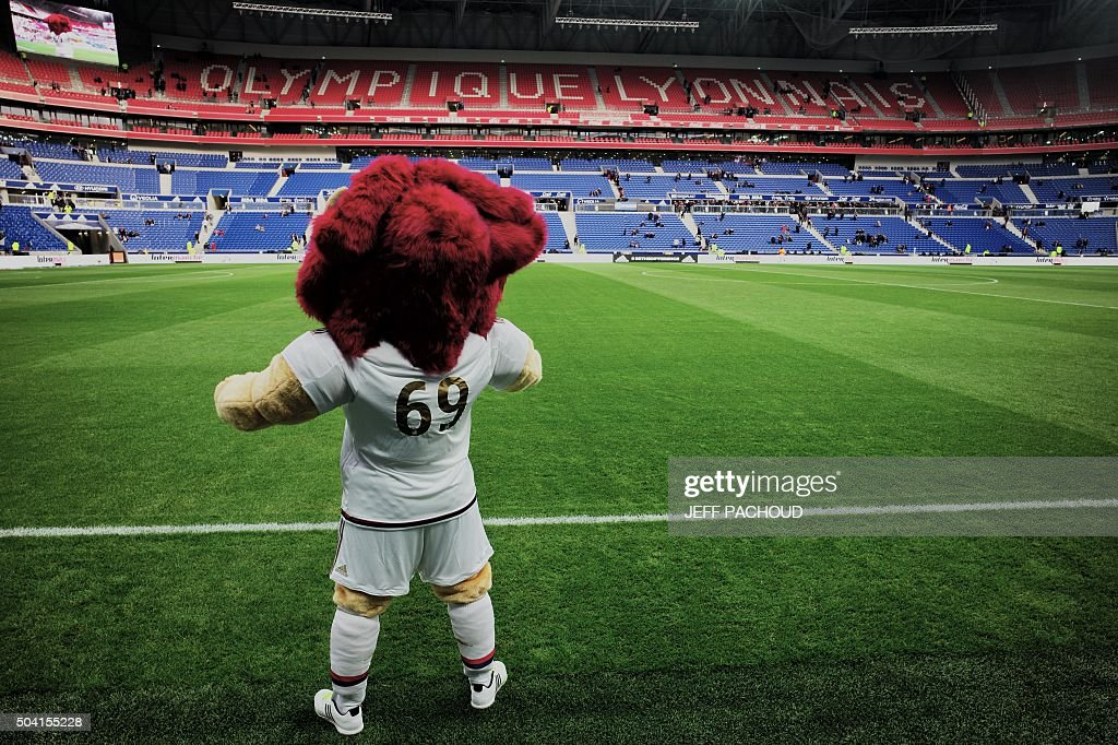 Olympique Lyonnais' mascot gestures prior to the French L1 football match between Olympique Lyonnais (OL) and Troyes on January 9, 2016, at the New Stadium in Decines-Charpieu, centraleastern France.