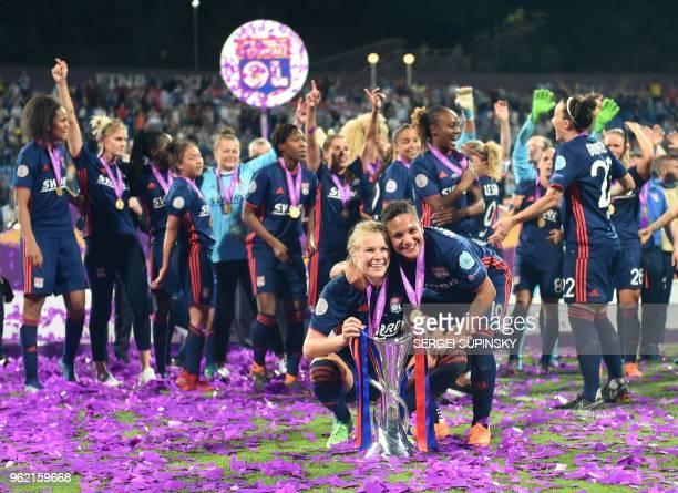 Olympique Lyonnais' Norwegian forward Ada Hegerberg and Olympique Lyonnais' Dutch forward Shanice Van De Sandern pose with the trophy as they...