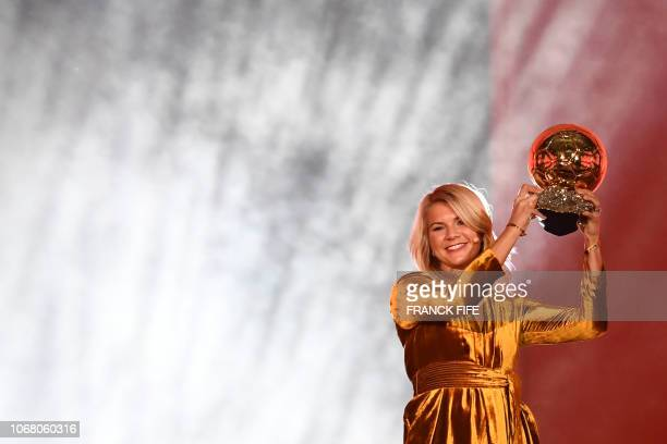 TOPSHOT Olympique Lyonnais' Norwegian forward Ada Hegerberg brandishes her trophy after receiving the 2018 Women's Ballon d'Or award for best player...
