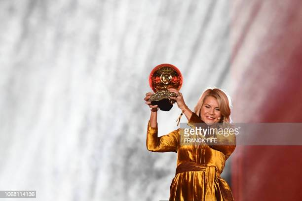 Olympique Lyonnais' Norwegian forward Ada Hegerberg brandishes her trophy after receiving the 2018 Women's Ballon d'Or award for best player of the...