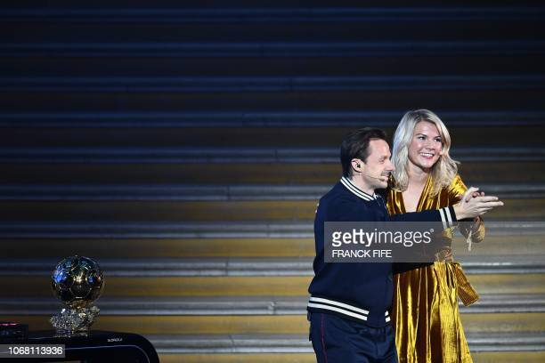 Olympique Lyonnais' Norwegian forward Ada Hegerberg dances with French DJ and producer Martin Solveig after receiving the 2018 Women's Ballon d'Or...