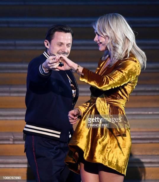 TOPSHOT Olympique Lyonnais' Norwegian forward Ada Hegerberg dances with French DJ and producer Martin Solveig after receiving the 2018 Women's Ballon...
