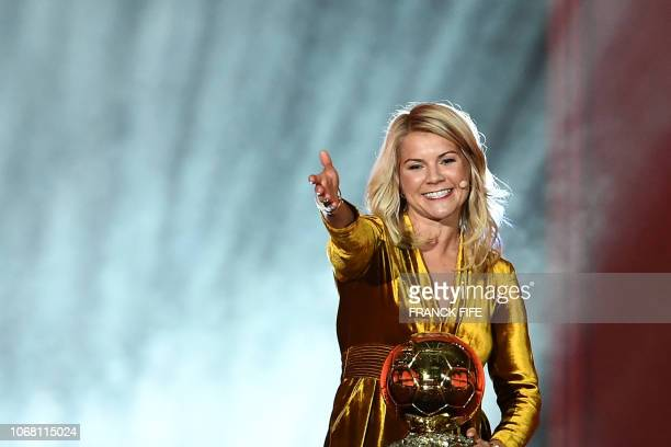 Olympique Lyonnais' Norwegian forward Ada Hegerberg gestures after receiving the 2018 Women's Ballon d'Or award for best player of the year during...