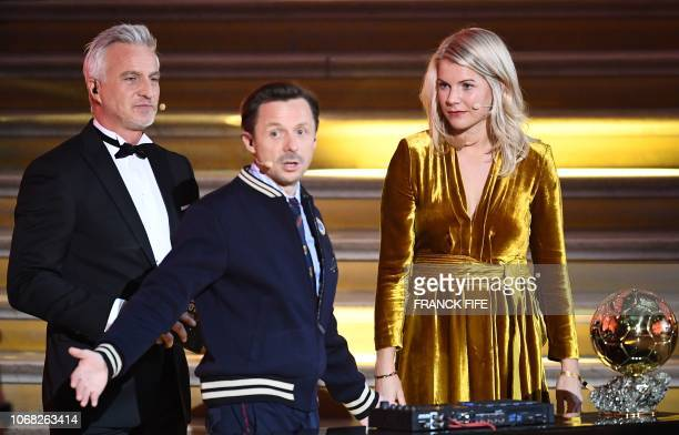 Olympique Lyonnais' Norwegian forward Ada Hegerberg looks on next to French former player and presenter David Ginola and French DJ and cohost Martin...