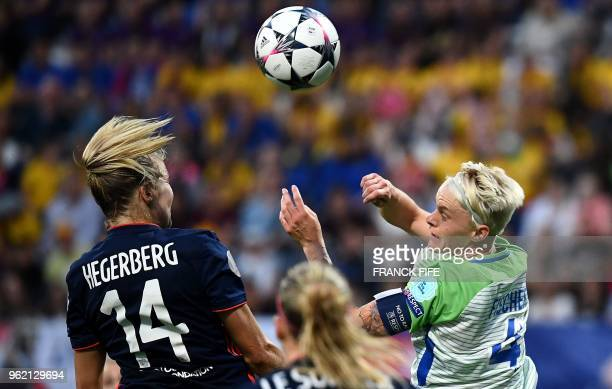Olympique Lyonnais' Norwegian forward Ada Hegerberg vies with Wolfsburg's Swedish defender Nilla Fischer during the UEFA Women's Champions League...