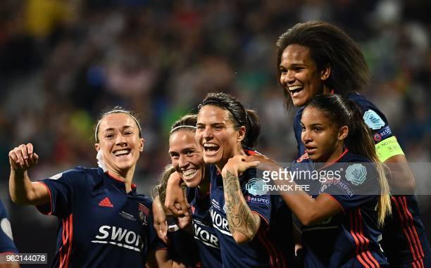Olympique Lyonnais' players celebrate after scoring their fourth goal during the UEFA Women's Champions League final football match Vfl Wolfsburg vs...