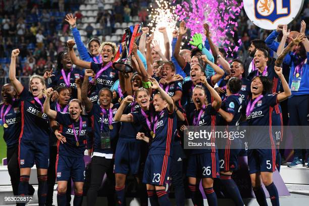 Olympique Lyonnais players celebrate after the UEFA Womens Champions League Final between VfL Wolfsburg and Olympique Lyonnais on May 24 2018 in Kiev...