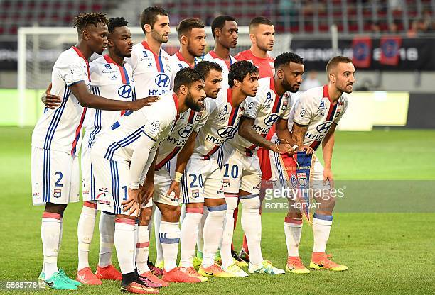 Olympique Lyonnais' players Lyon's French midfielder Jordan Ferri Lyon's French defender Jeremy Morel Lyon's French defender Rafael Pereira Da Silva...