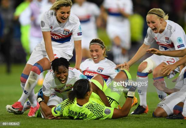 Olympique Lyonnais players race to celebrate with goalkeeper Sarah Bouhaddi who had scored the winning penalty during the UEFA Women's Champions...