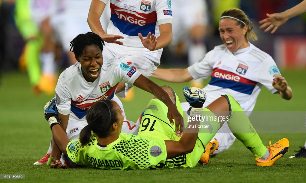 Olympique Lyonnais players race to celebrate with goalkeeper Sarah Bouhaddi who had scored the winning penalty during the UEFA Women's Champions League Final between Lyon and Paris Saint Germain at Cardiff City Stadium on June 1, 2017 in Cardiff, Wales.