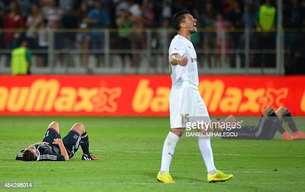Olympique Lyonnais players react after the UEFA Europa League playoff second leg football match Astra Giurgiu vs Olympique Lyonnais in Giurgiu...
