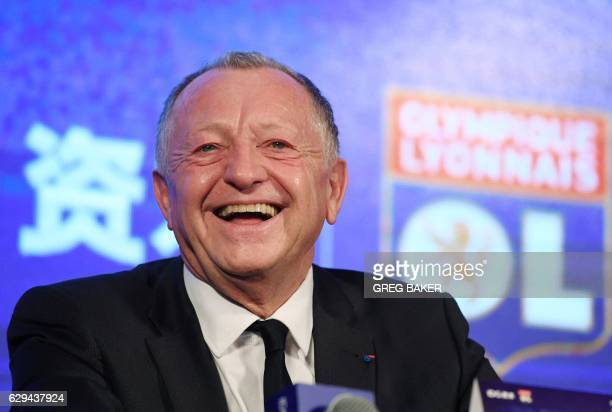 Olympique Lyonnais President JeanMichel Aulas laughs during a press conference after a signing ceremony in Beijing on December 13 2016 The ceremony...