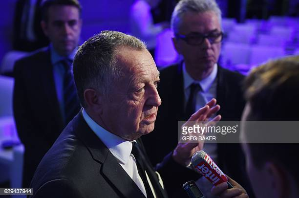 Olympique Lyonnais President JeanMichel Aulas speaks after a signing ceremony in Beijing on December 13 2016 The ceremony formalised Chinese...