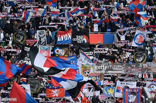 Olympique Lyonnais' supporters cheer during the French L1 football match between Olympique Lyonnais and Stade Malherbe Caen at the Parc de...