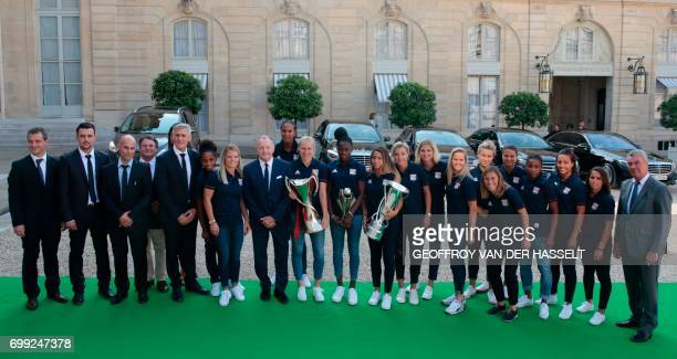 Olympique Lyonnais women football team and staff members pose at the Elysee Palace in Paris on June 20 2017 after they won the UEFA Women's Champions...