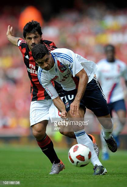 Olympique Lyonnais's Ederson vies with AC Milan's Gennaro Gattuso during their Emirates Cup football match at Emirates Stadium in London England on...