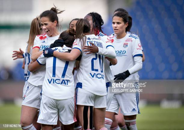 Olympique Lyon's English forward Nikita Parris celebrates with teammates after scoring during the Women's Champions League last 16 football match...