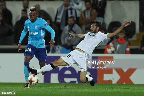 Olympique Marseille forward Clinton N Jie from Cameroon tries to escape Vitoria Guimaraes defender Joao Aurelio from Portugal during the match...