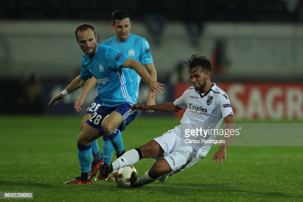 Olympique Marseille forward Valere Germain from France tackles Vitoria Guimaraes midfielder Francisco Ramos from Portugal during the match between...