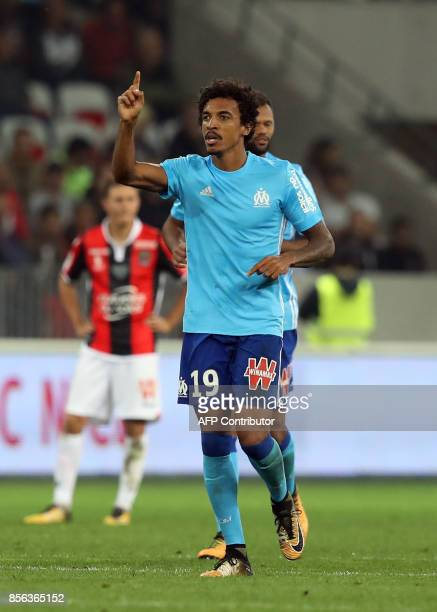 Olympique Marseille's Brazilian midfielder Luiz Gustavo celebrates after scoring a goal during the French L1 football match Nice vs Marseille on...