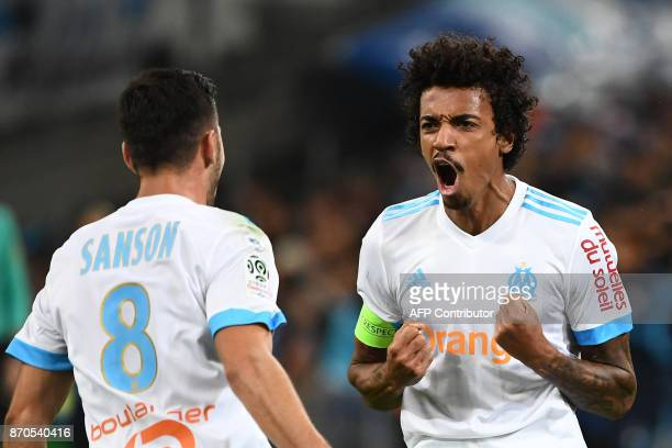 Olympique Marseille's Brazilian midfielder Luiz Gustavo celebrates after scoring a goal during the French L1 football match between Olympique of...