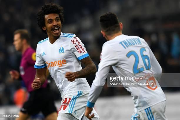 Olympique Marseille's Brazilian midfielder Luiz Gustavo celebrates with Olympique de Marseille's French midfielder Florian Thauvin after scoring a...