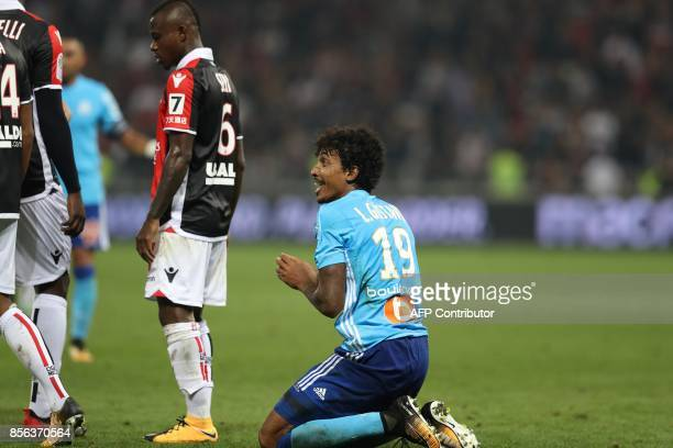Olympique Marseille's Brazilian midfielder Luiz Gustavo reacts after receiving a red card during the French L1 football match Nice vs Marseille on...