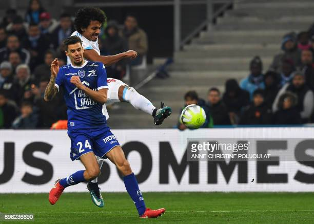 Olympique Marseille's Brazilian midfielder Luiz Gustavo scores a goal against Troyes' French midfielder Jimmy Giraudon during the French L1 football...