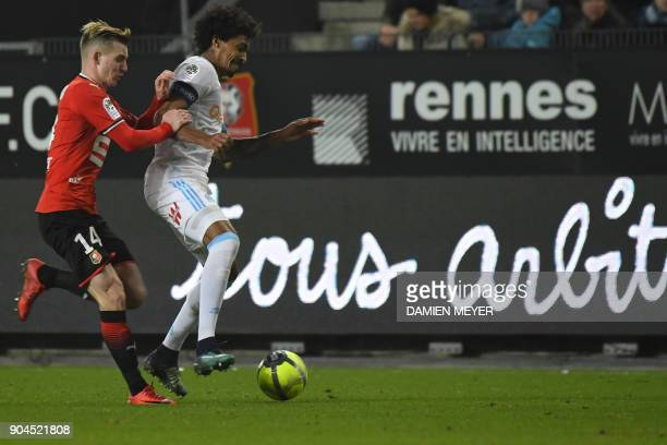 Olympique Marseille's Brazilian midfielder Luiz Gustavo vies with Rennes' French midfielder Benjamin Bourigeaud during the French L1 football match...
