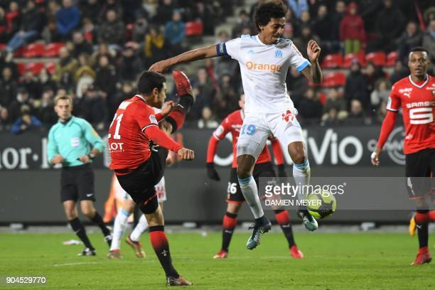 Olympique Marseille's Brazilian midfielder Luiz Gustavo vies with Rennes' French midfielder Benjamin Andre during the French L1 football match Rennes...