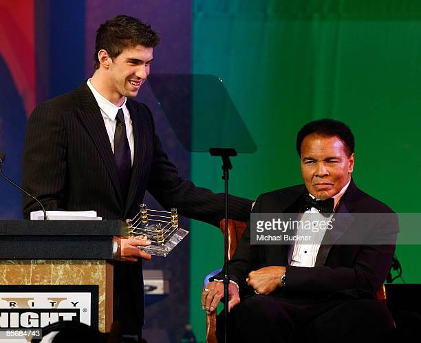 Olympis swimmer Michael Phelps and Muhammad Ali speak on stage during Muhammad Ali's Celebrity Fight Night XV held at the JW Marriott Desert Ridge...